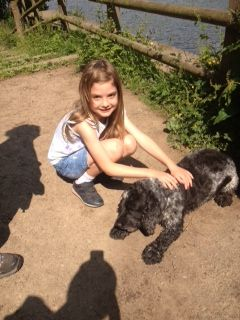 Katie and Oscar the dog catch their breath on the sponsored walk
