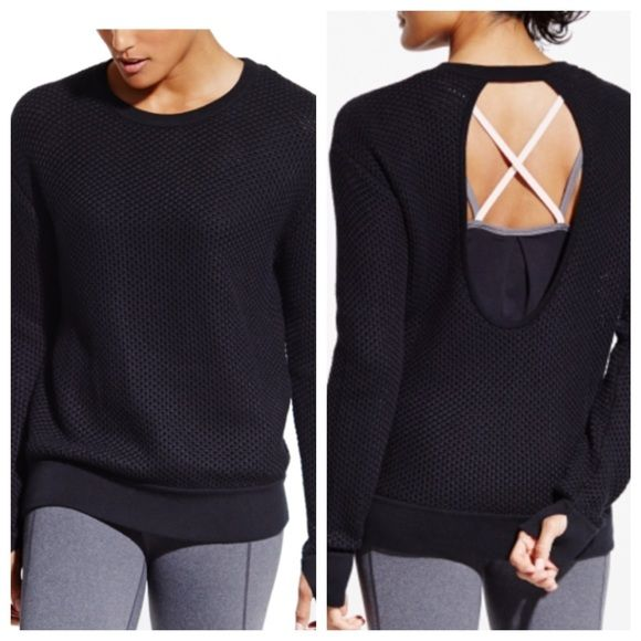 Calia by Carrie Underwood sweater Amazing sweater and perfect for those cold days heading to the gym. Thumb holes keep the sweater securely in place and open back makes this heavy sweater breathable with an athletic feel. 60% cotton and 49% acrylic. Pulls in fabric as shown in photo but does not take away from the high quality of this sweater. Looks awesome paired with the black hat for sale in my closet. CALIA by Carrie Underwood Sweaters