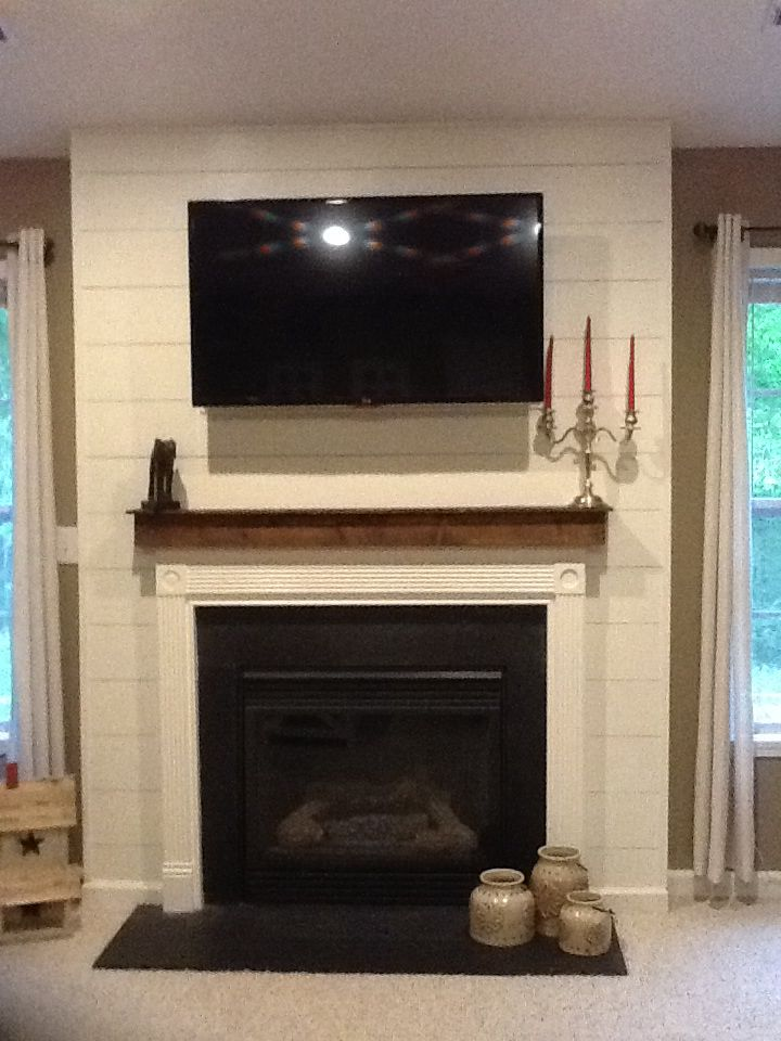 Shiplap fireplace surround with cedar mantle