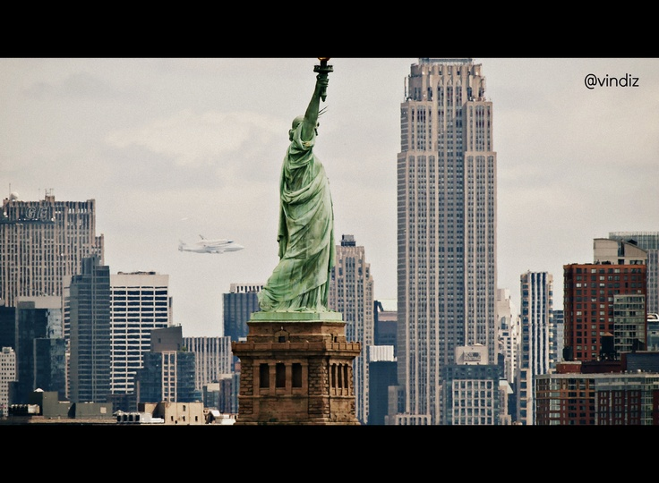 Awesome picture of the Space Shuttle Enterprise behind the Statue of Libery in @NYCgov. #KodakMoment