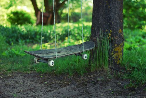 boogleloo:    Summer Stories by SmileyG    This one is made in my friends garden. It was her mom idea to make from skate swing.    I love this idea… great upcycling!    Always great to see new uses for old skateboards.