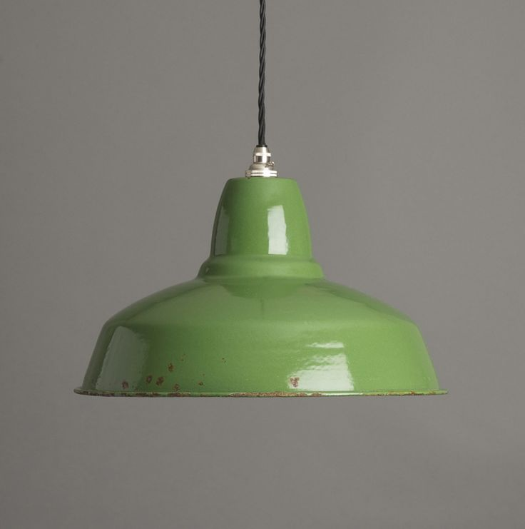 a deep green thorlux style industrial pendant factory light with white enamel interior this vintage industrial