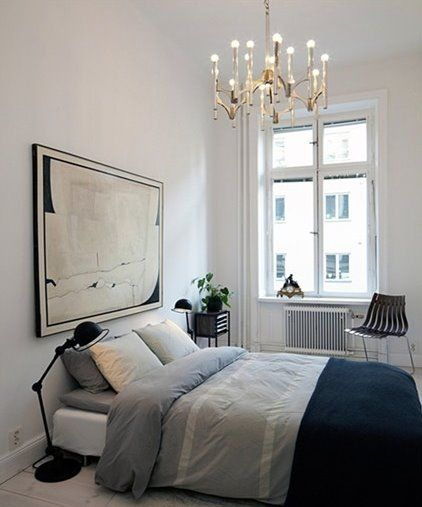 Source: Seventeen Doors. Elegant and contemporary. Love the lighing and side chair. Find a similar chandelier here.
