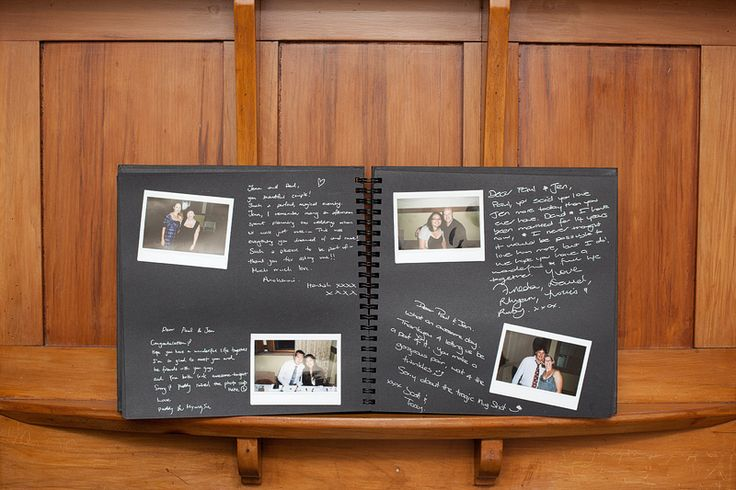 Have the photo booth pics or poloroids go in an album with a note from the guests. Much more personal than just signing their names
