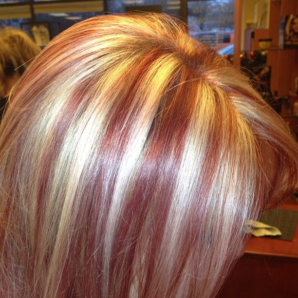 Blonde hair with bright red streaks