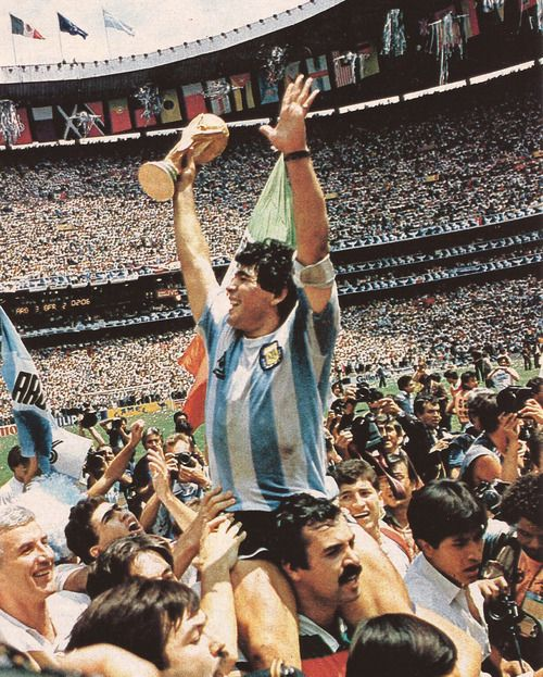 Diego Maradona, Football Legend, holding aloft the 1986 World Cup trophy.
