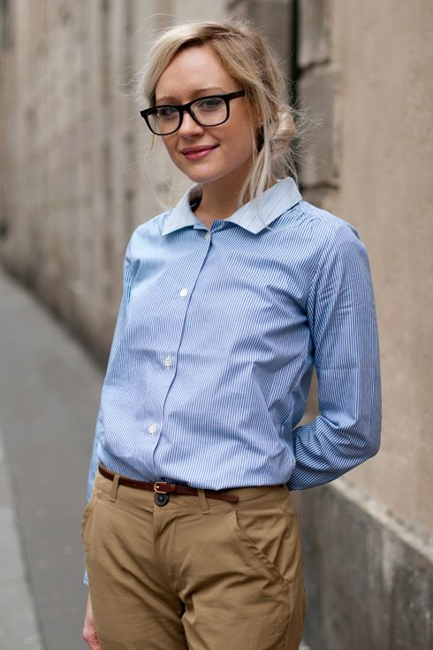 Honestly, I like this look. It's professional, the hairstyle gives off a flirty and fun vibe, the glasses (which aren't totally necassary) are kind of nerdy cute, and the skinny belt adds just that slight bit of fashion to it.
