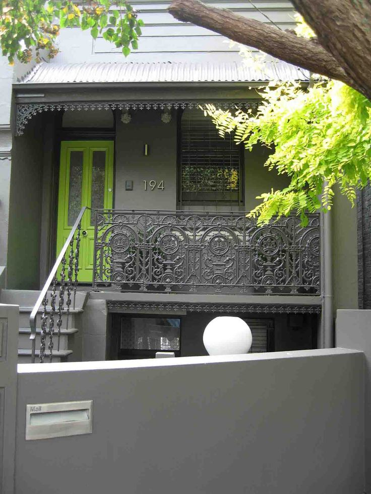 Terrace House - dark grey with a bring green front door. Decorator: Jeni Jewell Designs