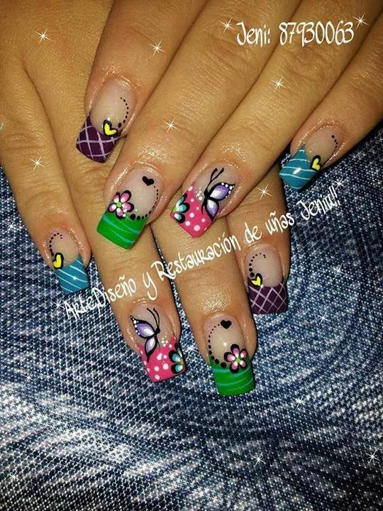 French tip acrylics, butterfly, flowers, polka dots.