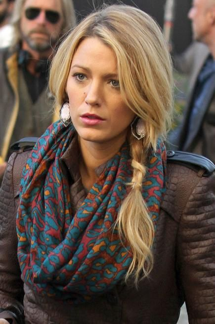 This effortless look is just as easy as it looks. Twist or braid hair off to one side, leaving tendrils loose around the face. Secure with a clear elastic two or three inches above where you normally would end the braid. #hairstyles #blakelively