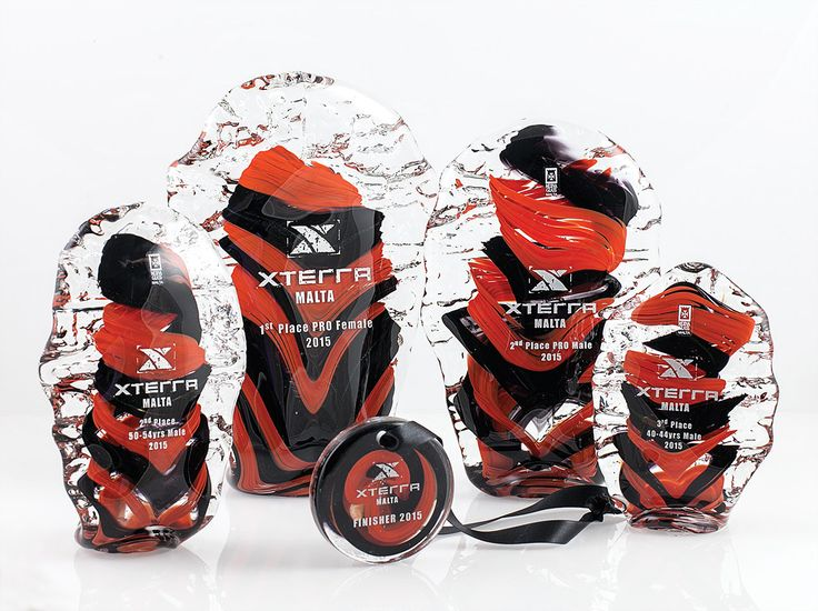 Set of handmade trophies and medal produced by Mdina Glass for the Xterra international triathlon event, Malta 2015.