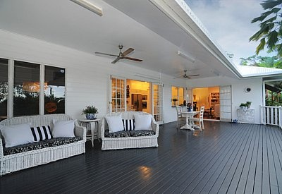 modern queenslander verandah - huge! Love the undercover lounge with the ceiling fan