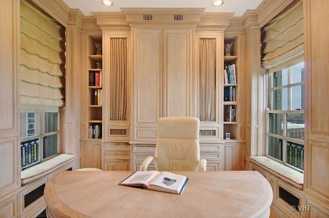 Contemporary Home Office with Hardwood floors, Built-in bookshelf, Crown molding, Window seat