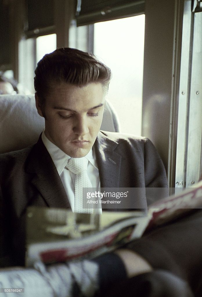 Alfred Wertheimer/Getty Images) On the New York to Memphis train, American musician (and actor) Elvis Presley (1935 - 1977) reads a magazine, July 3 or 4, 1956. Elvis had been in a New York for appearance on the 'Steve Allen Show' and to record the songs 'Hound Dog' and 'Don't Be Cruel'; he was on his way home to Memphis.