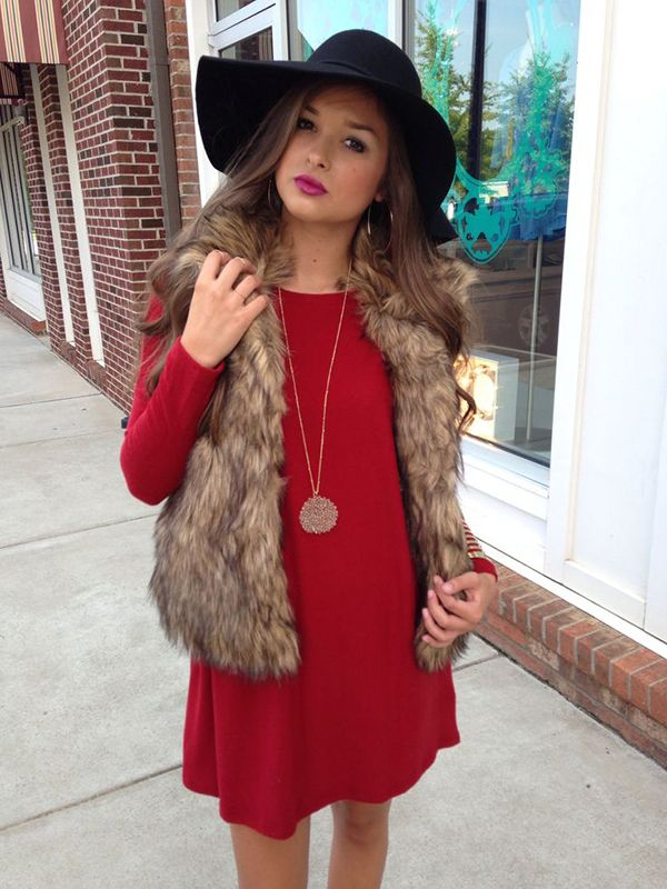 i'm kind of obsessed with this red dress worn under this fur vest. the floppy hat is also amazing