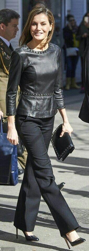 Letizia - Leather peplum top embellished with metal studs by Uterqüe - Hugo Boss trousers and clutch - Prada heels