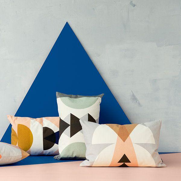Beautiful Fabric Patten In Pillows Design : Unusual Pillows Among Semi Circle Motifs Near Cream Floor Near Grey Wall Also Blue Panel