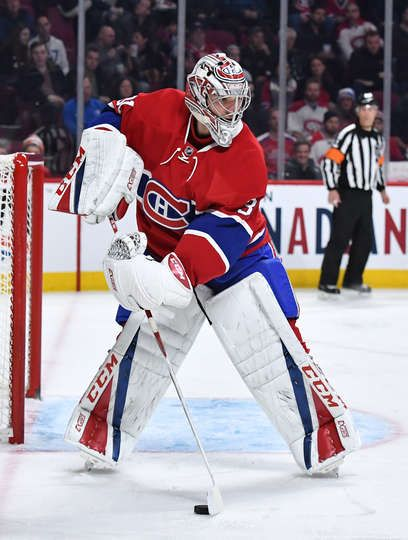 MONTREAL, QC - DECEMBER 10: Carey Price #31 of the Montreal Canadiens clears the puck against the Colorado Avalanche in the NHL game at the Bell Centre on December 10, 2016 in Montreal, Quebec, Canada. (Photo by Francois Lacasse/NHLI via Getty Images)