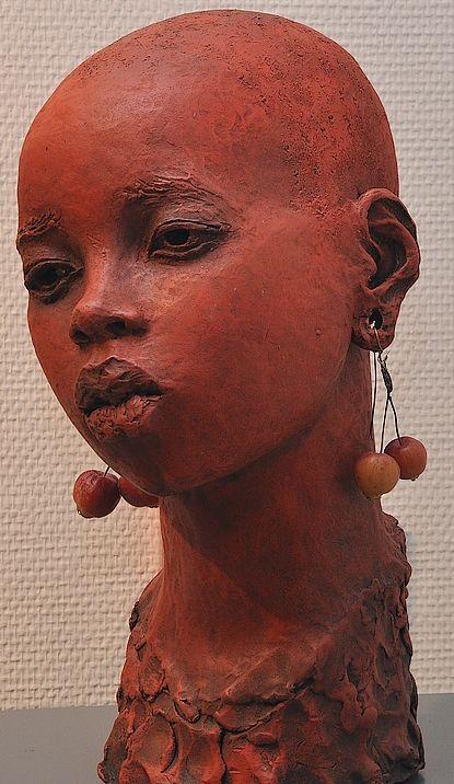 escultura...                                                       …