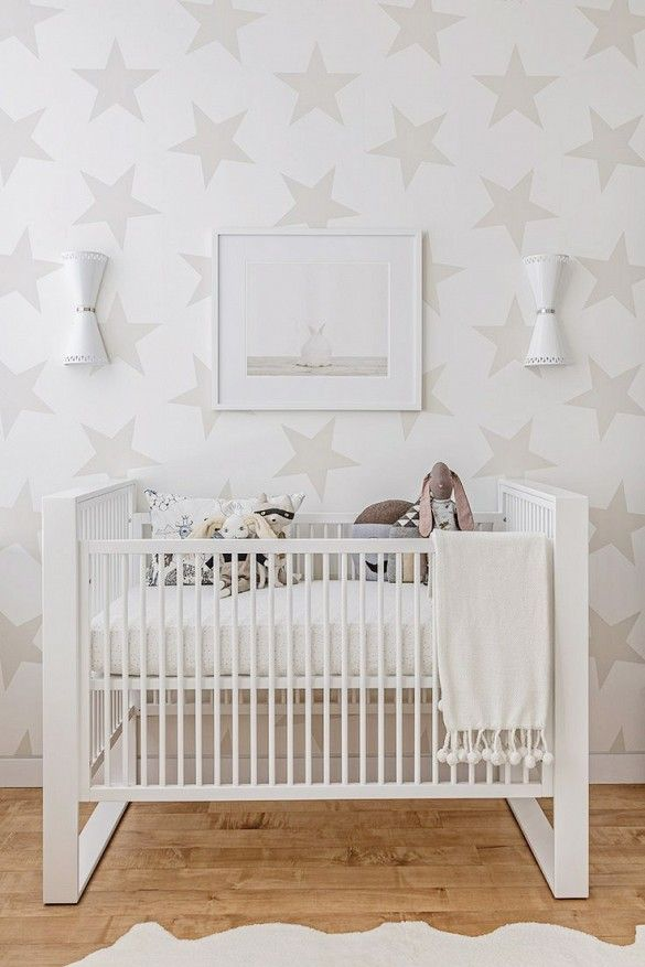 Oversized star wallpaper remains chic thanks to its subdued, dove-gray colorway and the tonal décor of the space as a whole.