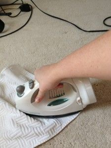Cleaning stain out of carpet with an iron and Windex