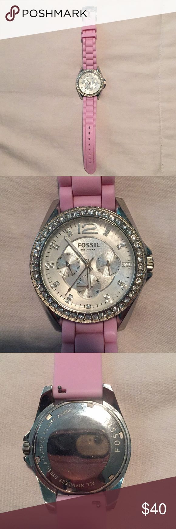 Fossil watch Pink fossil watch with crystals around the clock. Needs new battery Fossil Jewelry