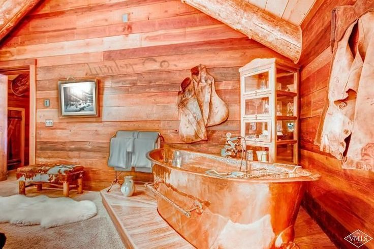 Have you ever seen a copper bathtub?! This log cabin in Colorado is for sale.