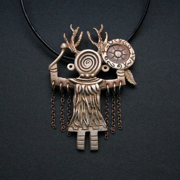 shamanic knowledge -run by song - bronze clay pendant by Anna Fidecka