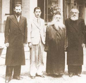 """Prof. Kotsuji (2nd to left) with Rabbi Shlomo Shapira (l) and the Amshinover Rebbe and Rabbi Moshe Shatzkes. """"We will never forget what you did for us when we were in Japan,"""" the sage continued. """"Nor how you risked your life to save us. The merit of that mesirus nefesh [self-sacrafice] is what stood in your stead and led you to seek shelter under the wings of the Shechina [Divine presence] and to become a genuine member of the Nation you helped so much."""""""