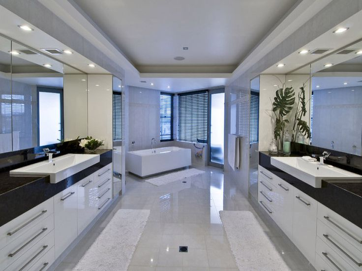 photo of a modern bathroom design with spa bath using frameless glass from the bathroom galleries