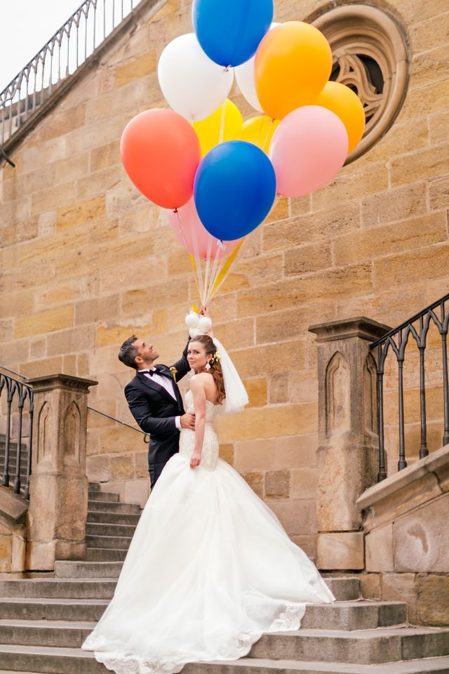 Wedding couple with ballons under the Charles Bridge in Prague