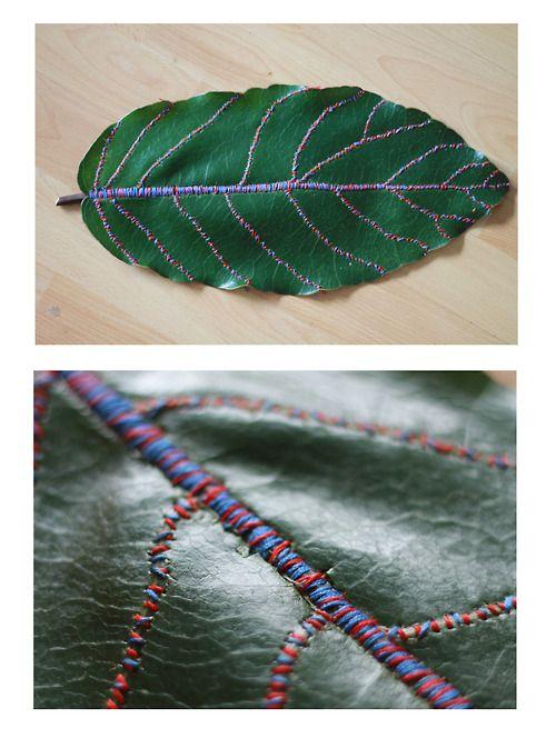 Embroidery thread on leaf.