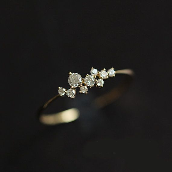 This beautiful unique style ring features 9 Brilliant Moissanite. Tie the knot with this unique ring.  Material: 14K White Gold ( Available in