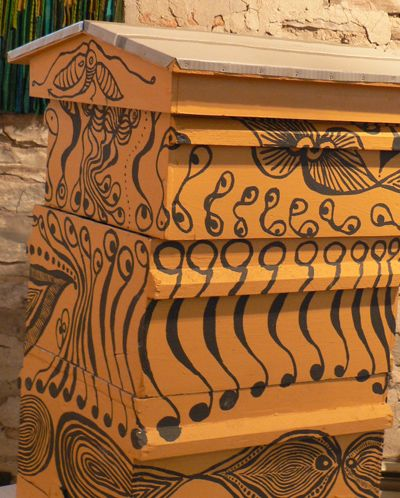 Painted bee hives (for the bees to differentiate their box from others)