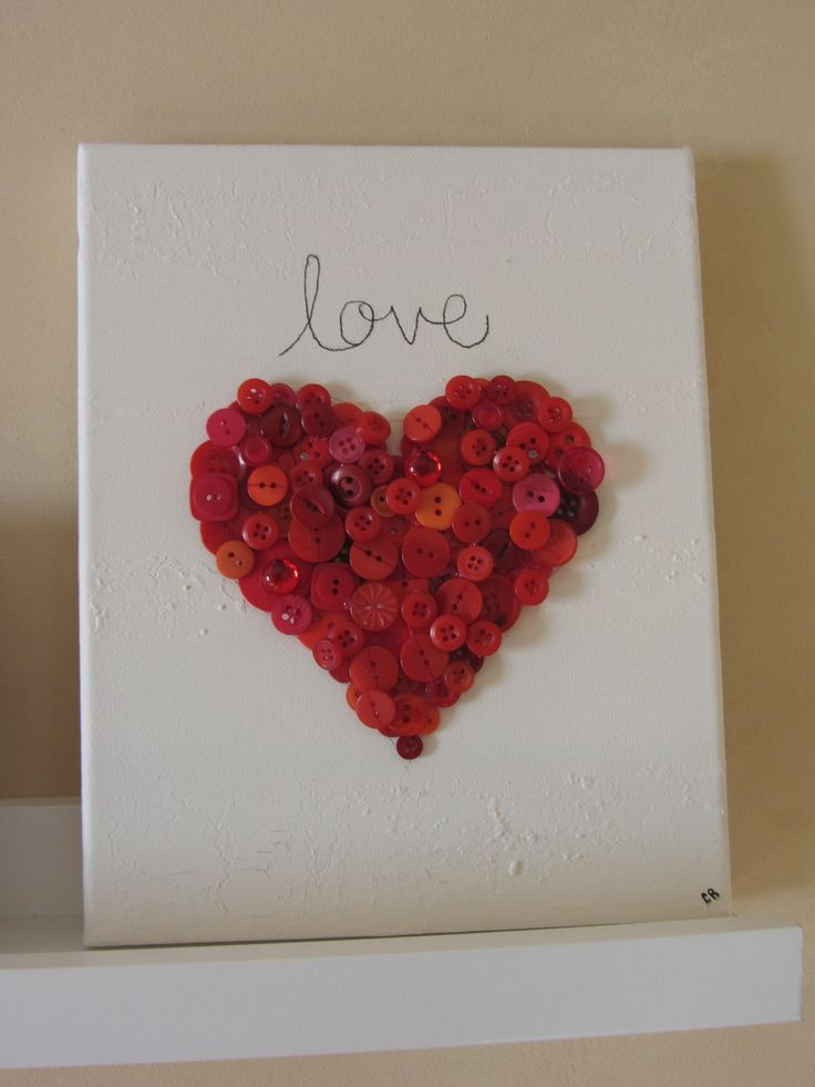 just use a hot glue gun to glue buttons in the shape of a heart onto a canvas and use a sharpie to write the word love.
