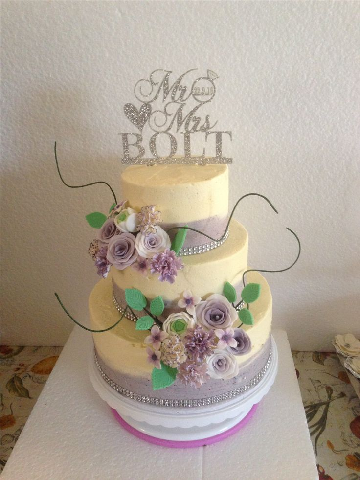 Lavender buttercream wedding cake with gum paste flowers