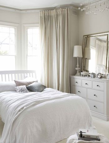 Create space with neutral bedroom accessories