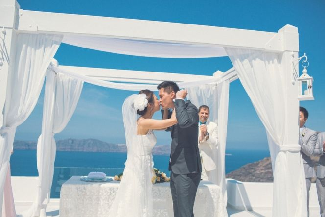Ceremony at Dana Villas | Santorini Wedding | Design By Stella and Moscha - Exclusive Greek Island Weddings | Photo by Chris Spira | http://www.stellaandmoscha.com