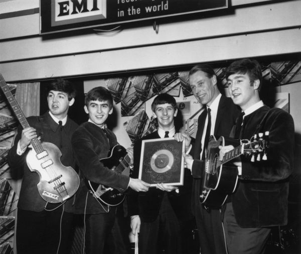 """The Beatles, shown on April 8, 1963, with producer George Martin, were introduced to a national television audience in the U.S. by """"CBS Morning News"""" anchor Mike Wallace on Nov. 22, 1963, hours before President John F. Kennedy was assassinated in Dallas. (Chris Ware / Getty Images / April 8, 1963)"""