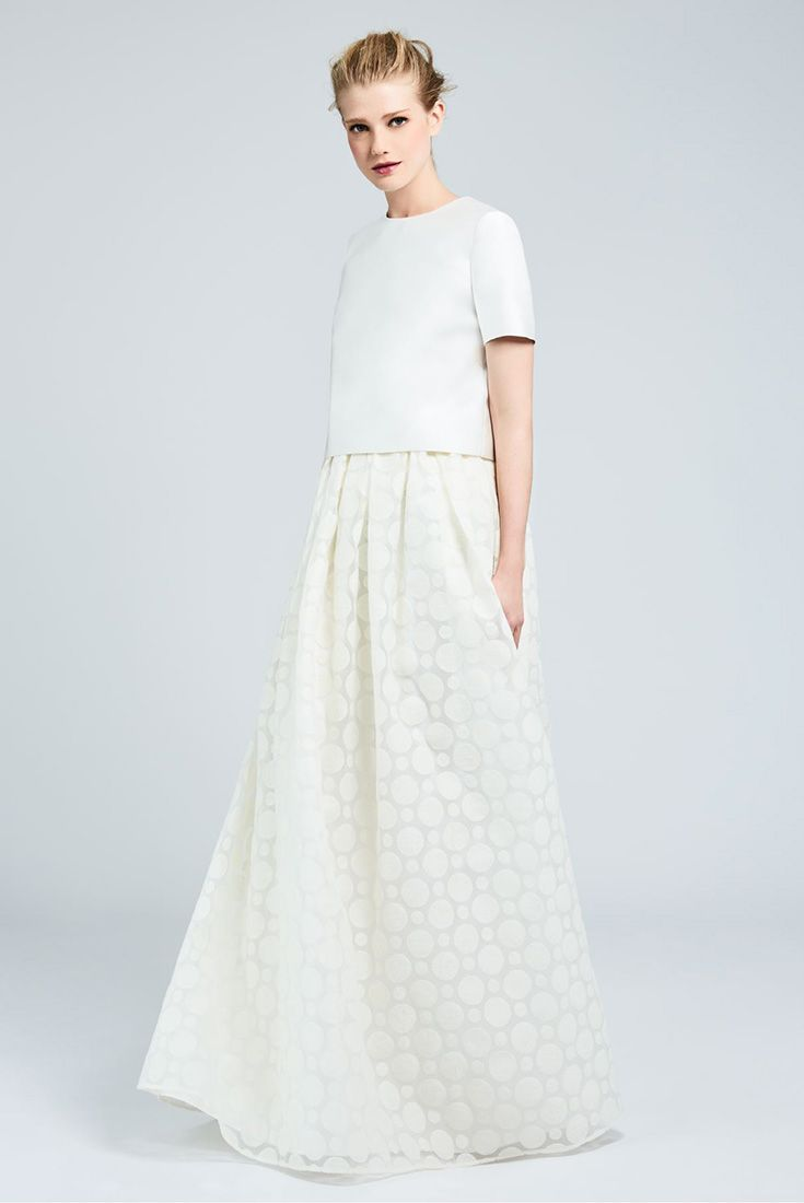 ANICE, two-piece dress with a boxy short-sleeve top in double duchesse and silk blend, and a long romantic organza skirt, decorated with milk-white polka-dot embroidery. #MaxMaraBridal #weddingdress #abitodasposa