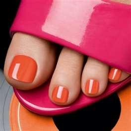 orange nail polish with pink peep-toe shoe