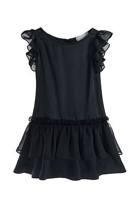 Little Black Ruffle Dress. The perfect Little Black Dress for little girls. A simple A-Line cut with a chiffon ruffle detail on each shoulder, and on the lower part of the dress. Simple and elegant. 100% Polyester excluding trims. Hand wash or Cold Machine Wash.
