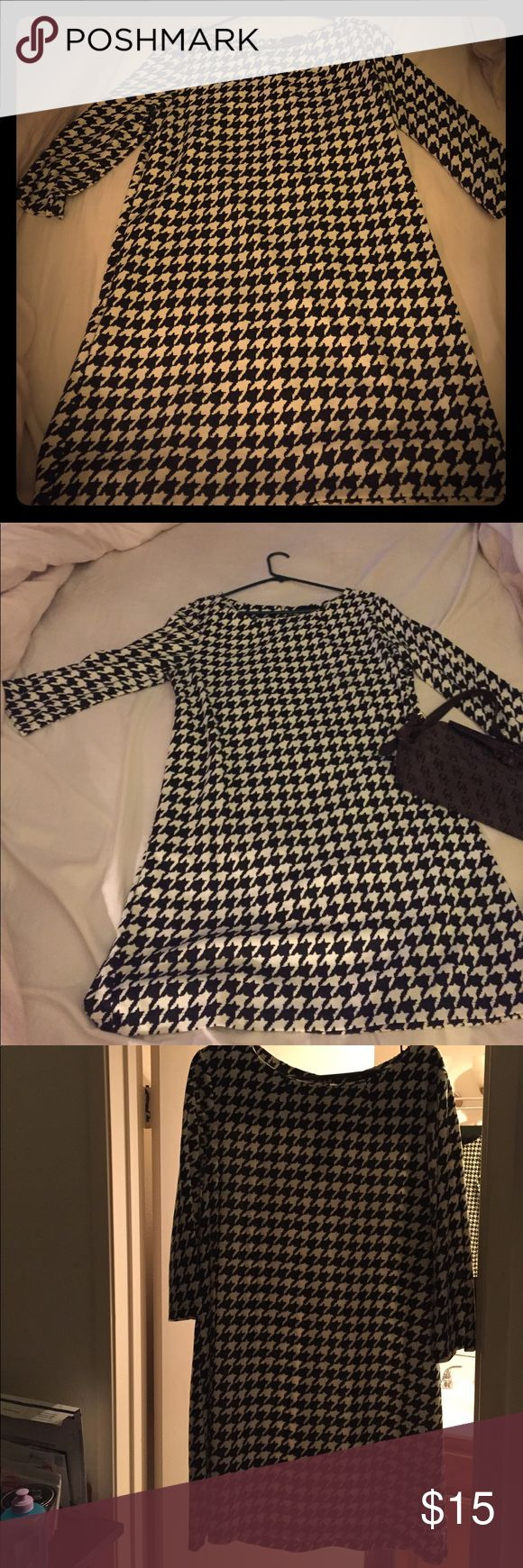 Black and white above the knee dress from H&M Brand new black and white houndstooth designed dress from H&M. Never worn but super cute. Small gold zip up back. Pairs well with heels or boots. H&M Dresses