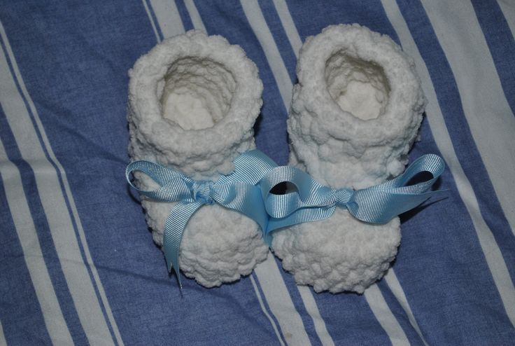 """My version of the """"10 Minute Booties""""  I used a thick chenille yarn and a 3.75mm hook. The cuffs are only 3 rows instead of the 5 rows that the pattern calls for.  Also, they took considerably more than 10 minutes, but still easily completed in less than a day."""