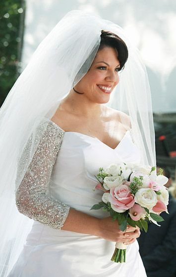Sara Ramirez played Dr. Callie Torres wed Arizona Robbins (Jessica Capshaw) in 2011 on Grey's Anatomy. Callie wore a white ball gown with jeweled sleeves by Amsale.
