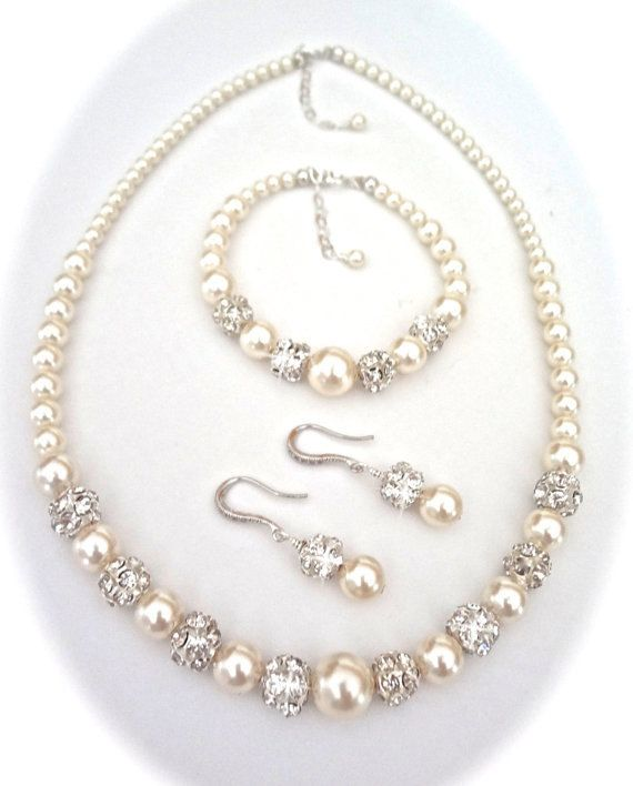 Queen Me Jewelrys BEST selling jewelry, Pearl set ~3 piece ~ Brides jewelry set. Graduating pearl jewelry ~ I cannot say enough about this TOP SELLING pearl set. It is gorgeous and elegant. It is perfect bridal jewelry. This affordable pearl set is high quality. It offers sterling silver ear wires, and clasps. As well as being made with SWAROVSKIS® famous crystalized pearls and his sparkling crystal balls. It is defiantly bride worthy but would also make amazingly maid of honor, bridesmaid…