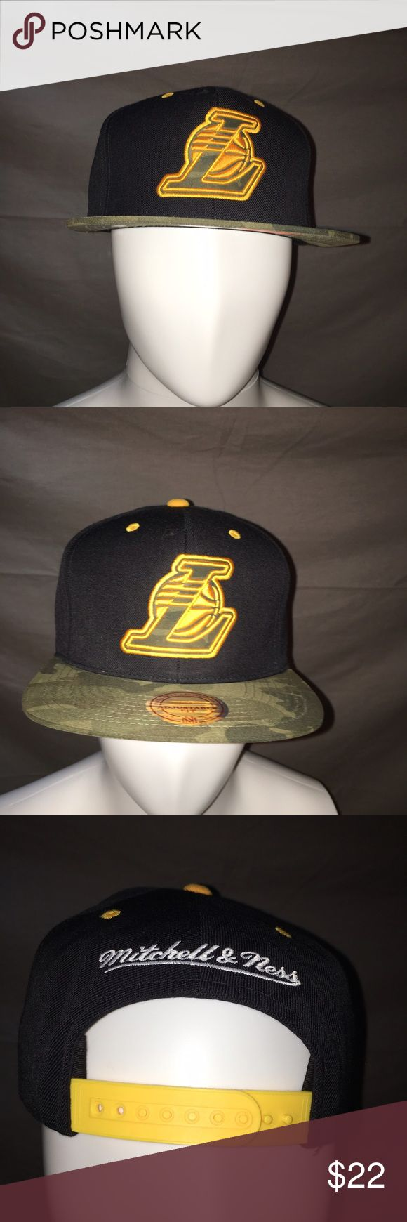 Mitchell and Ness Lakers SnapBack Hat. Brand new with tags Mitchell and Ness Los Angeles Lakers Hat. Mint condition. Camouflage brim, yellow snaps. Definitely different from all the rest. Great for any Lakers fan. Mitchell & Ness Accessories Hats