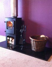 Charnwood Cove 1 on log store, granite hearth, twin wall insulated chimney