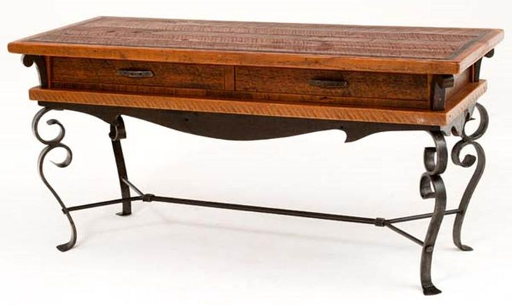 A hand forged metal base in a western design is paired with a distressed reclaimed barn wood top for a unique south western sofa or console table. Custom Sizes