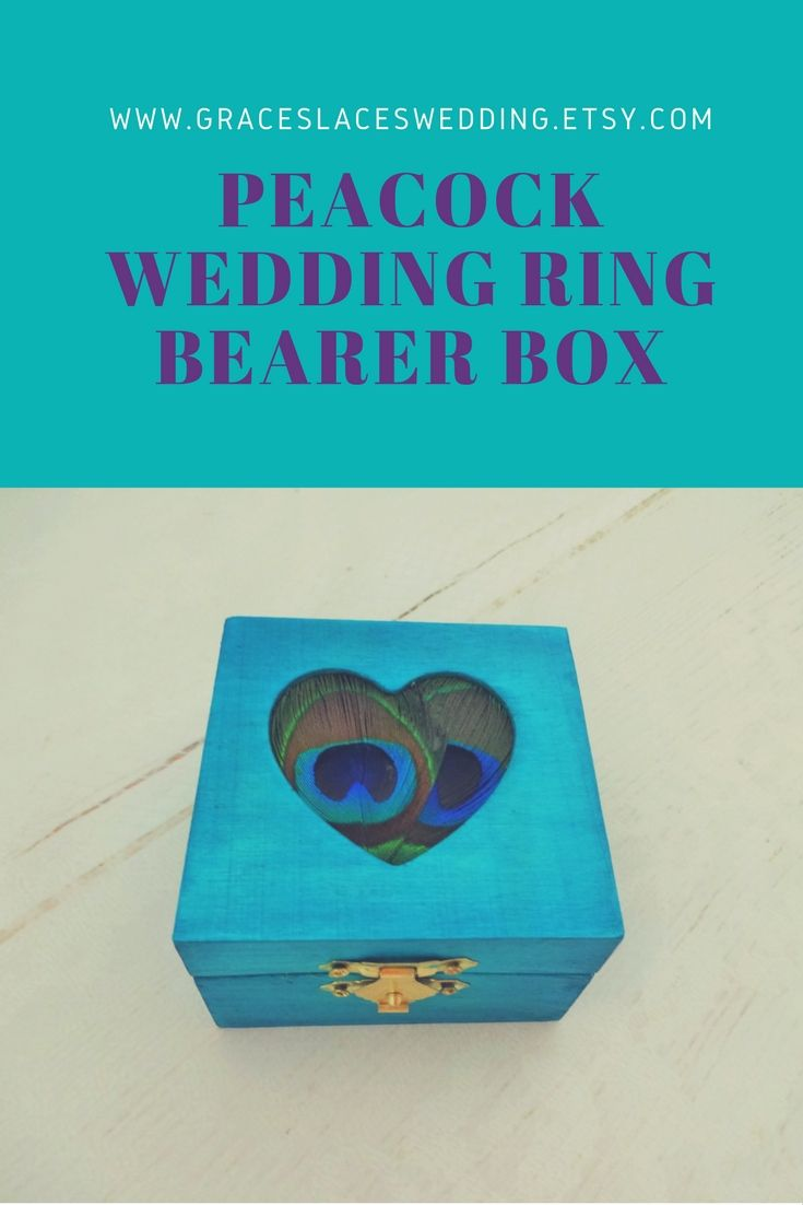 Beautiful ring bearer box for peacock wedding theme #peacockwedding #peacockringbox #peacockbearerbox #peacocktheme #peacockfeather